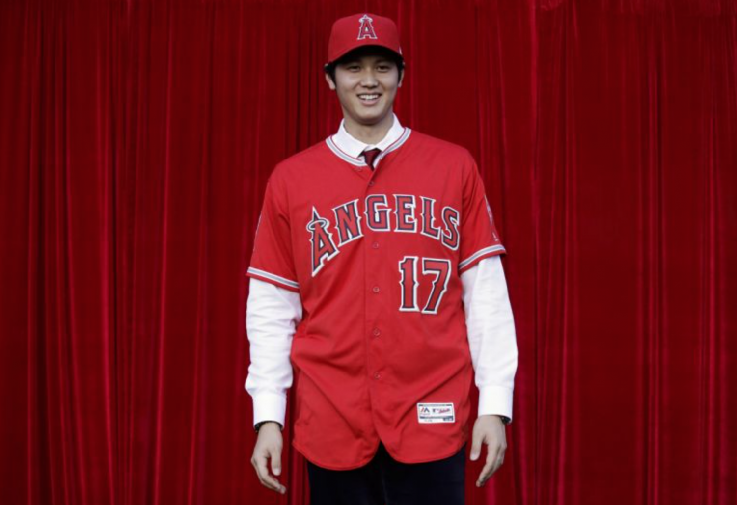 Ohtani poses in an Angels kit. Photo: Twitter/@SSSportsTalk.