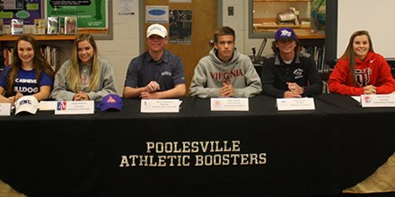 Student signees pose in their college's gear. Photo: Twitter/@PHSathletics