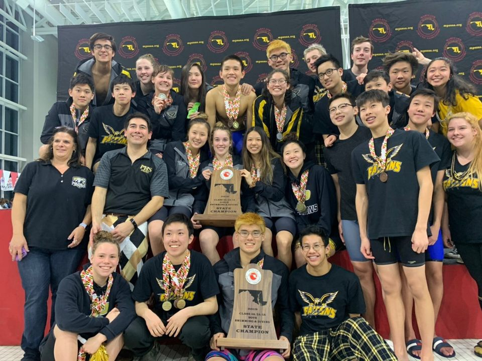 PHS swim team poses on podium after winning first place in Maryland State Class 2A/3A Championship meet. This marks the team's eighth consecutive win.