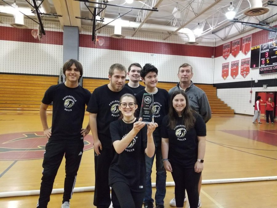 Members of the Bocce Team and Coach Lang celebrate with their Division IV trophy!